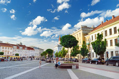 VILNIUS, LITHUANIA - AUGUST 11, 2016: The Town Hall Square at the end of the Pilies Street is a traditional centre of trade and ev Royalty Free Stock Image