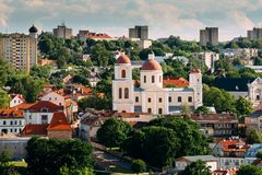 Vilnius, Lithuania. Bastion Of Vilnius City Wall And Orthodox Church Of The Holy Spirit In Summer Day. Vilnius Old Town. Vilnius, Lithuania. Aerial View of The Stock Photos