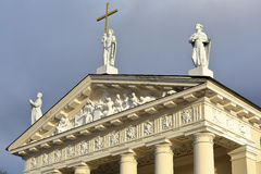 VILNIUS, LITHUANIA: The Cathedral on Cathedral Square showing details of sculptures on the pediment. The Cathedral on Cathedral Square showing details of Stock Image