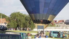Heated air in a balloon and takeoff. Vilnius, Lithuania - circa July, 2017: Heated air in a balloon and takeoff stock footage