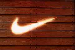Vilnius Lithuania. Close Glowing Logotype Swoosh Of Nike Brand. Vilnius, Lithuania - July 08, 2016: Close The Glowing Yellow Logotype Swoosh Of Nike Brand At Stock Photography