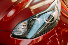 Vilnius Lithuania. Close Left Headlight Of New Red Kia Sportage Stock Image