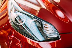 Vilnius Lithuania. Close Left Headlight Of New Red Kia Sportage Stock Images