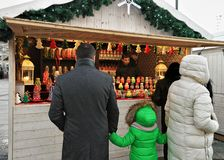 Family at counter on Christmas market at Cathedral Square Vilnius Stock Photography