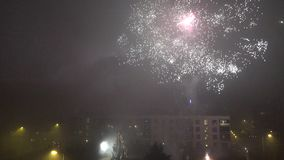 People celebrate new year in flat house yard and lot of fireworks blow in sky. Vilnius, Lithuania - December 06, 2016: people celebrate new year in flat house stock video footage