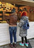 People at Xmas stand on Christmas market at Cathedral Square Royalty Free Stock Image