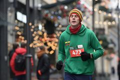 Runner on traditional Vilnius Christmas race stock photo