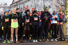 Runners on start of traditional Vilnius Christmas race stock photos