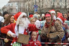Runners on start of traditional Vilnius Christmas race stock images