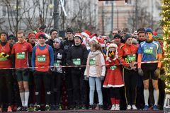 Runners on start of traditional Vilnius Christmas race stock photography
