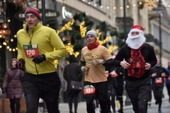 Runners on traditional Vilnius Christmas race royalty free stock photo
