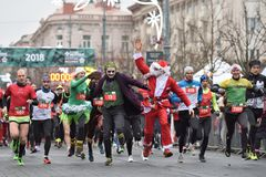 Runners on traditional Vilnius Christmas race royalty free stock image