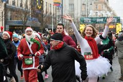 Runners on traditional Vilnius Christmas race stock images