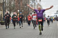 Runners on traditional Vilnius Christmas race stock image