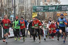 Runners on traditional Vilnius Christmas race stock image
