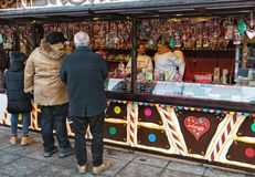 Senior People at Christmas candy house in Vilnius. Vilnius, Lithuania - December 4, 2016: Senior People at Christmas candy house on Xmas market on Cathedral royalty free stock images