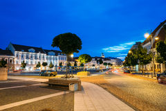 Vilnius Lithuania. Evening View Of Illuminated Didzioji Street With Red Motion Blur Effect On Road Royalty Free Stock Photography
