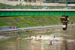 Vilnius, Lithuania. Group Of Young People Stand Up Paddling SUP Royalty Free Stock Photo