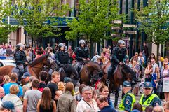 Armed mounted police forces riding at the end of Pride parade on Gedimino street. Event celebrating lesbian, gay, bisexual,. Vilnius, Lithuania - July 27, 2013 royalty free stock photo