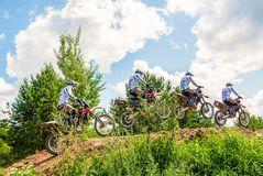 A group of amateur motorcyclists practice their manoeuvres. This is a multiple exposure shot taken on public land. Vilnius, Lithuania - July 14, 2013: A group of royalty free stock photography