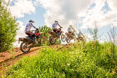 A group of amateur motorcyclists practice their manoeuvres. This is a multiple exposure shot taken on public land. Vilnius, Lithuania - July 14, 2013: A group of stock photos