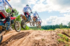 A group of amateur motorcyclists practice their manoeuvres. This is a multiple exposure shot taken on public land. Vilnius, Lithuania - July 14, 2013: A group of stock photography