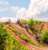 A group of amateur motorcyclists practice their manoeuvres. This is a multiple exposure shot taken on public land. Vilnius, Lithuania - July 14, 2013: A group of stock image