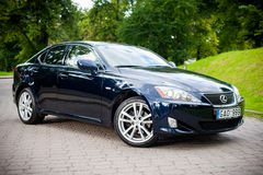VILNIUS, LITHUANIA - JULY 10, 2012: Luxury Lexus Car. Green Grass and Park in background. Luxury Lexus Car. Green Grass and Park in background Royalty Free Stock Images