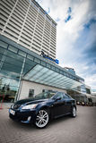 VILNIUS, LITHUANIA - JULY 10, 2012: Luxury Lexus Car. Vilnius Cityscape in Background. Hotel Radisson Blu Stock Image