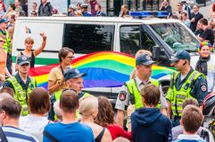 Police forces ensuring safety during the Pride parade on Gedimino street full of people. Event celebrating lesbian, gay, bisexual. Vilnius, Lithuania - July 27 royalty free stock photography