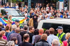 Pride parade in action. Crowd of watchers and demonstrators with rainbow flags. Event celebrating lesbian, gay, bisexual,. Vilnius, Lithuania - July 27, 2013 royalty free stock image