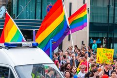 Pride parade in action. Crowd of watchers and demonstrators with rainbow flags. Event celebrating lesbian, gay, bisexual,. Vilnius, Lithuania - July 27, 2013 stock photo