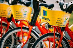 Row Of Colorful Bicycles AVIVA For Rent At Municipal Bike Parkin Stock Photography
