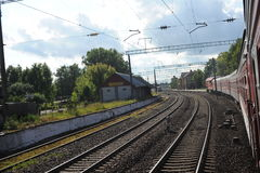 VILNIUS, LITHUANIA - JUNE 26, 2011: Lithuania Railway Network and Track. Going on Fast Train. Approaching To Station Stock Photo