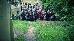 Public congregation procession carrying cross on hill. VILNIUS, LITHUANIA - JUNE 02, 2017: Public congregation procession carrying cross on hill. Static shot. 4K stock video