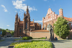 Vilnius. LITHUANIA - JUNE 7, 2016: St. Anne's Church and Saints Francis and Bernardine Church and Adam Mitskevich statue in , Lithuania Stock Image