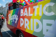 Baltic Pride poster on the bus at event supporting LGBT community rights, gay parade demonstration with rainbow flag royalty free stock image