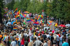 Big crowd of people supporting LGBT community in Baltic Pride event. People with rainbow royalty free stock photo
