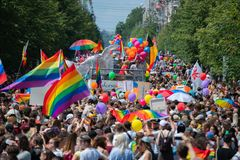 Big crowd of people supporting LGBT community in Baltic Pride event. People with rainbow stock photo