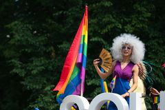 SOHO bus with drag queens at Baltic Pride event, men dressed as woman on gay parade royalty free stock photography