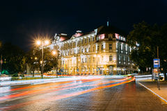 Vilnius Lithuania. Kempinski Hotel Cathedral Square In Bright Night Illumination On Universiteto Street. Vilnius, Lithuania. View Of Kempinski Hotel Cathedral Royalty Free Stock Image
