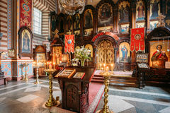 Vilnius Lithuania. Lectern Analogion With Two Icons For Veneration Stock Image