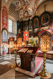 Vilnius Lithuania. Lectern Analogion With Two Icons For Veneration Stock Photo