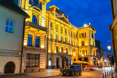 Vilnius Lithuania. Lithuanian National Philharmonic Society Building In Bright Evening Illumination Stock Image