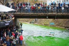 VILNIUS, LITHUANIA - MARCH 18, 2017: Hundreds of people enjoying festivities and celebrating St. Patrick`s day in Vilnius. Vilnele river was dyed green to mark Royalty Free Stock Images