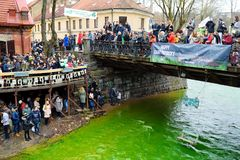 VILNIUS, LITHUANIA - MARCH 18, 2017: Hundreds of people enjoying festivities and celebrating St. Patrick`s day in Vilnius. Vilnele river was dyed green to mark Stock Photography