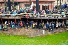 VILNIUS, LITHUANIA - MARCH 18, 2017: Hundreds of people enjoying festivities and celebrating St. Patrick`s day in Vilnius. Vilnele river was dyed green to mark Stock Photo