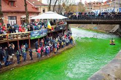 VILNIUS, LITHUANIA - MARCH 18, 2017: Hundreds of people enjoying festivities and celebrating St. Patrick`s day in Vilnius. Vilnele river was dyed green to mark Royalty Free Stock Photography