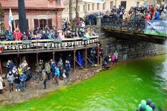 VILNIUS, LITHUANIA - MARCH 18, 2017: Hundreds of people enjoying festivities and celebrating St. Patrick`s day in Vilnius. Vilnele river was dyed green to mark Royalty Free Stock Photo