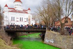 VILNIUS, LITHUANIA - MARCH 18, 2017: Hundreds of people enjoying festivities and celebrating St. Patrick`s day in Vilnius. Vilnele river was dyed green to mark Royalty Free Stock Image